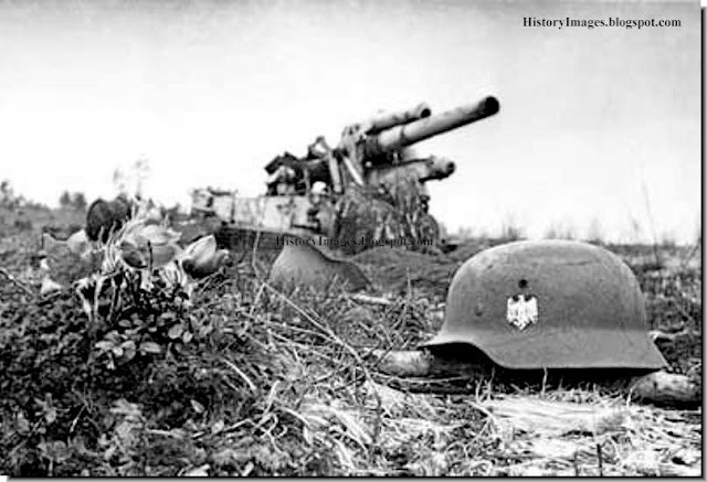 A destroyed German gun and a German grave in Belarus