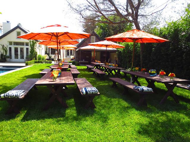 Outdoor backyard baby shower COCOCOZY logo throw orange umbrellas