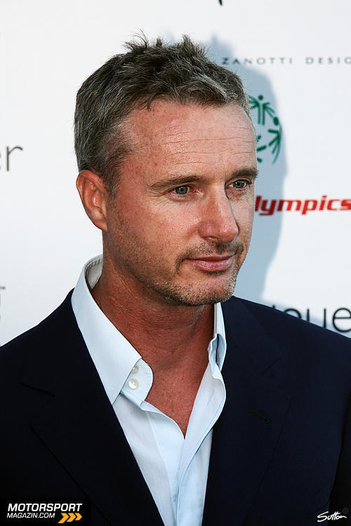 Eddie Irvine with a weight of 74 kg and a feet size of N/A in favorite outfit & clothing style
