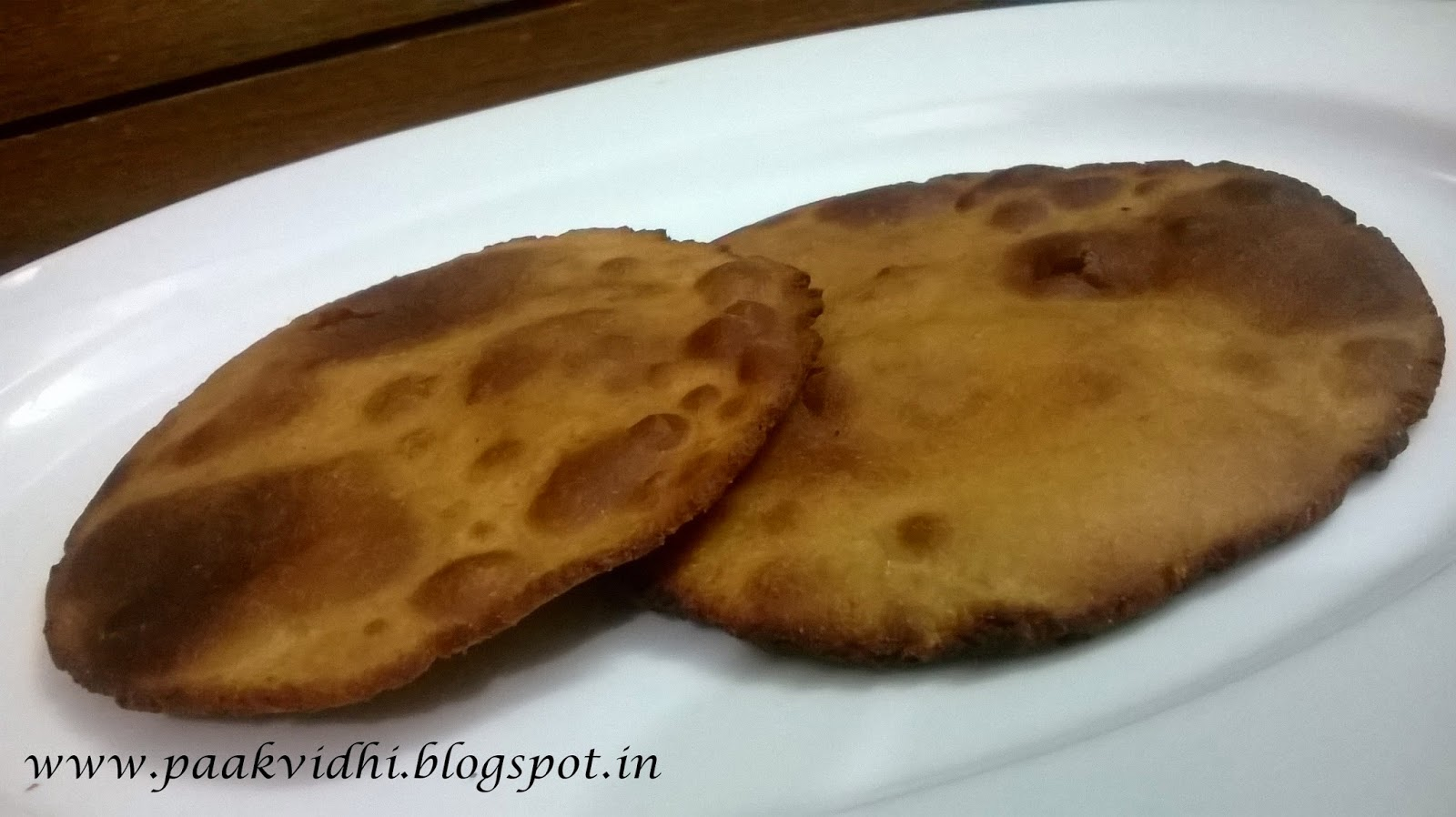 http://paakvidhi.blogspot.in/2014/03/basadia-meethi-gur-ki-poorigur-ki-roti.html