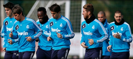 Real Madrid players training with blue jersey