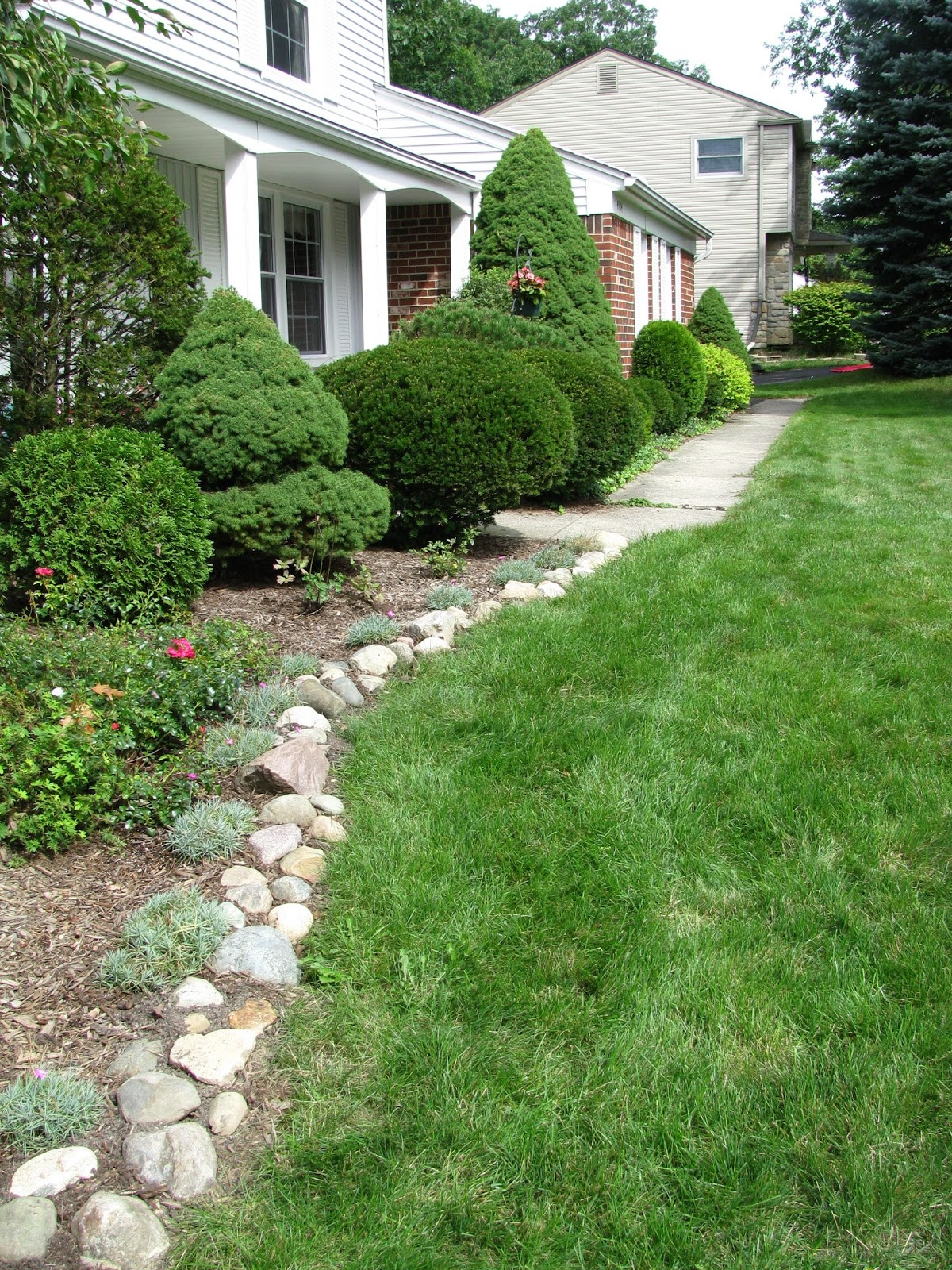 flower beds with rock borders native home garden design