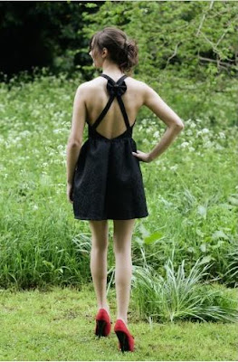 http://www.lmflmf.co.uk/hourglass-shape/Dahlia-Sophia-Black-Jacquard-Cross-Back-Dress-with-Bow-Detail