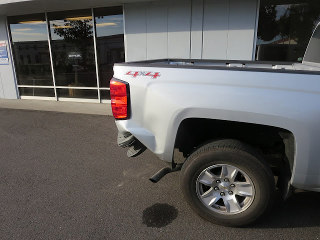Collision damage on Chevy Silverado before repairs at Almost Everything Auto Body