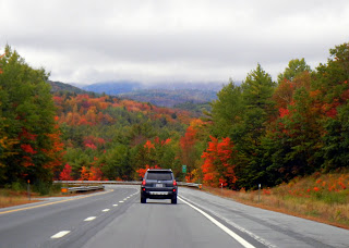Driving through New Hampshire during peak Fall season in New England