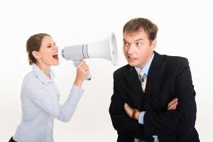عدم الإنصات بين الأزواج يشعل الخلافات - business-man-listening-to-woman-with-load-hailer