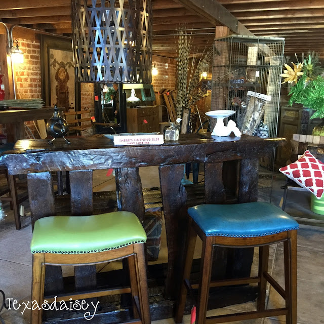 Look what I found at Gordon's Furniture! A beautiful unique bar with stools