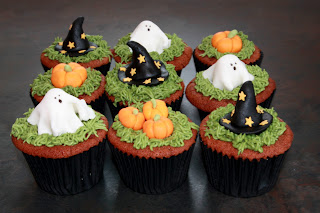 9 Halloween Red Velvet cupcakes topped with ghosts, pumpkins and witches' hats