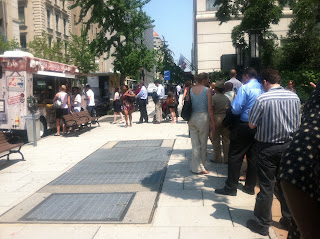 People lined up nearly one block for a food truck selling lobster rolls