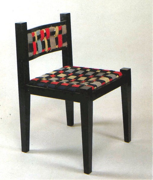 Chair by Marcel Breuer in collaboration with Gunta Stölzl Pear, polished black  Seat and back of plaited woolen straps 1921