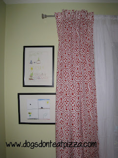 Red curtains against light green walls - thediybungalow.com
