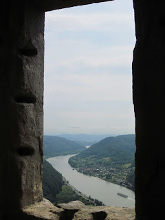 Looking through a window opening at the Danube, from Burgruine Aggstein near Melk in Austria eoiguh