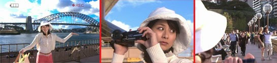 Sekiyama poses in front of the bridge, but when she's filming, she catches sight of Tsutsumi talking with a woman.