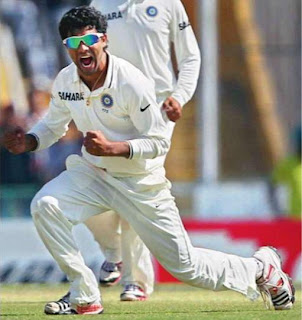 Ravindra Jadeja celebrates the wicket of Australian batsman Phillip Hughes on the final day