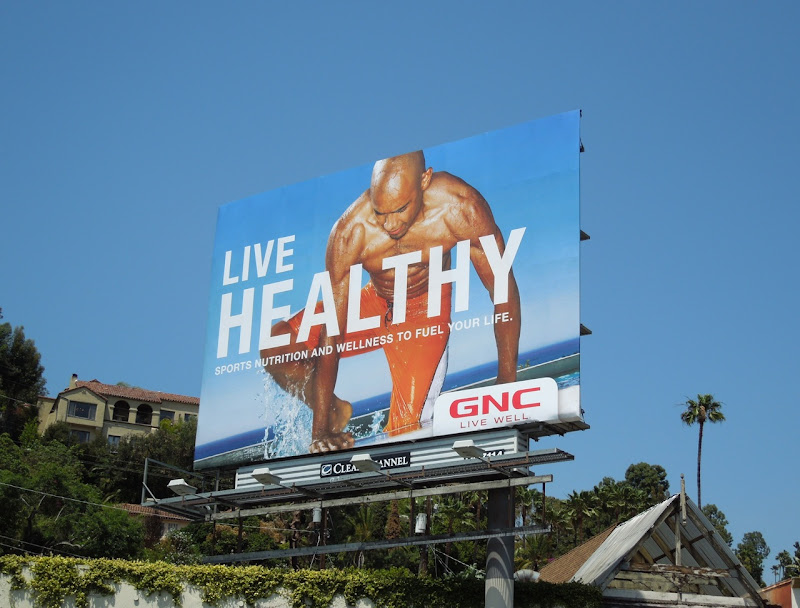 Live Healthy GNC swimmer billboard
