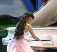 GuiGui Zheng นักเปียโนไม่มีนิ้วมือ