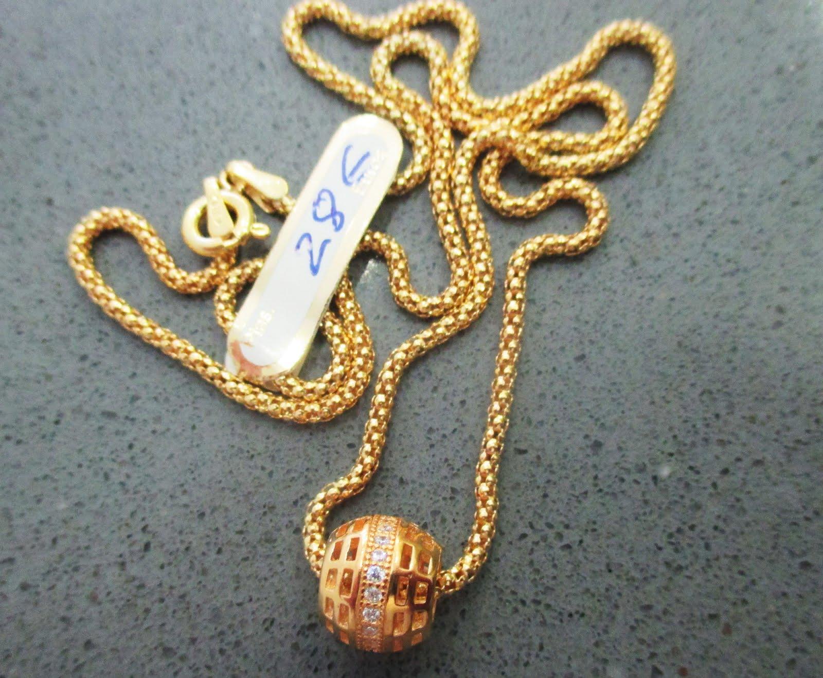 Cadena y colgante plata dorada