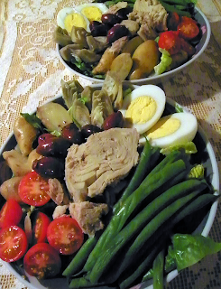 Two Bowls of Salade Nicoise Heaped with Veggies and Fish and Eggs