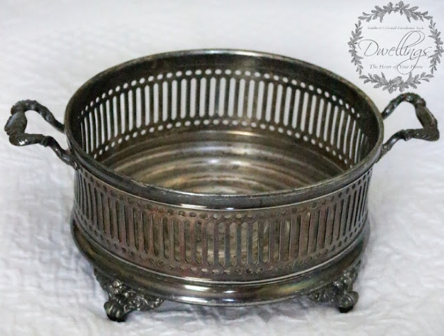 Silver dish turned candle holder.