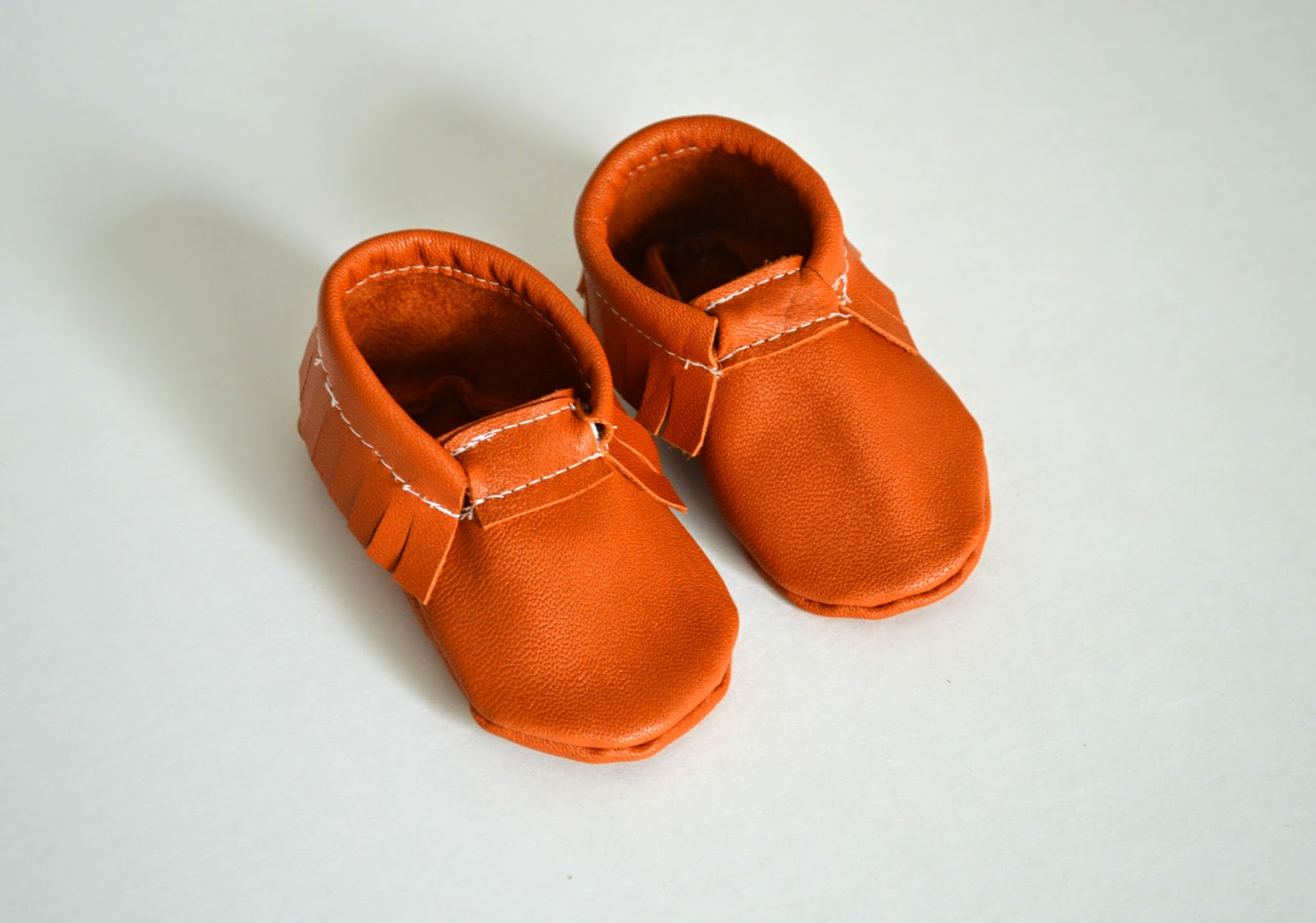 the faithful feather baby moccasins