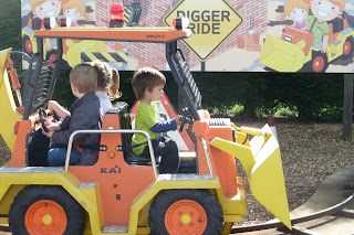 Our toddler on the Digger ride at Peppa Pig World, Paultons Park