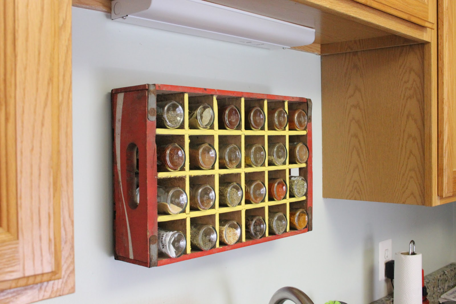 itu0027s a simple wooden soda crate used as a spice rack perfect for situations like mine where kitchen space is very very limited and prized - Spice Storage