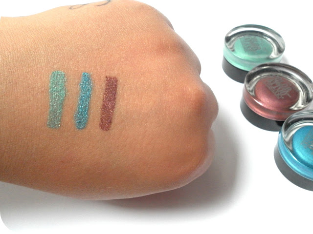 A picture of Maybelline Color Tattoo swatches in Edgy Emerald, Tenacious Teal and Pomegranate Punk