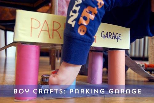 boy_crafts_parking_garage_cars_pre-school_toilet_paper_rolls_cereal_box_recycle
