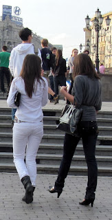 Girl in white tight jeans on the street