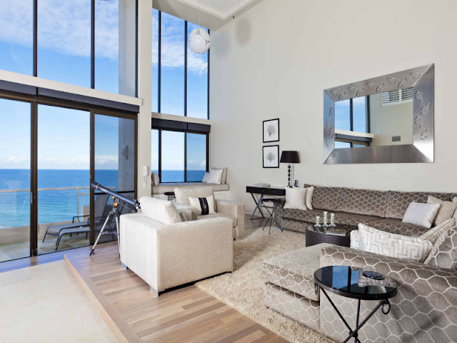 Two-floor glass wall with the ocean view