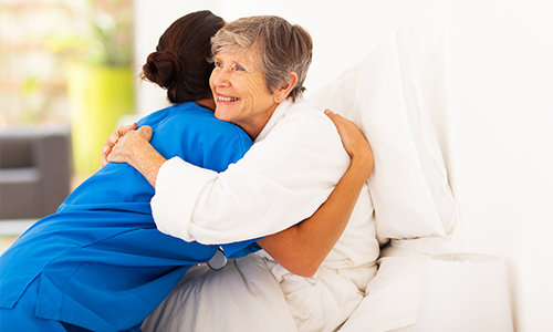 Woman hugging a nurse.