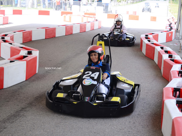 The beautiful Maya Karin on a fully electric powered go-kart