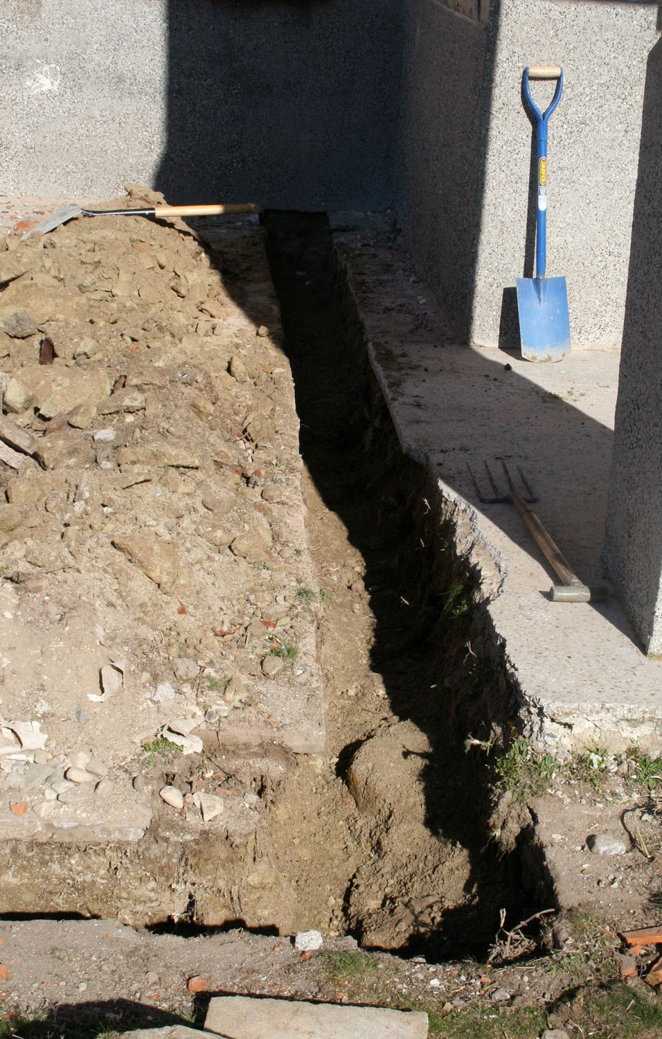 Continuing the trench to the wall