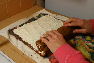 Hands Beginning to Roll Cake Up