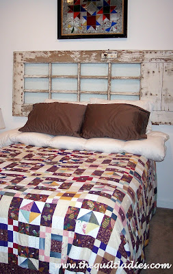 Old wooden door made into a head board