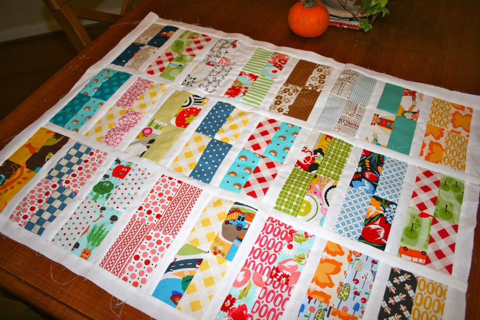 The tulip patch skinny 4 patch scrap quilt in progress - Alfombras de patchwork ...