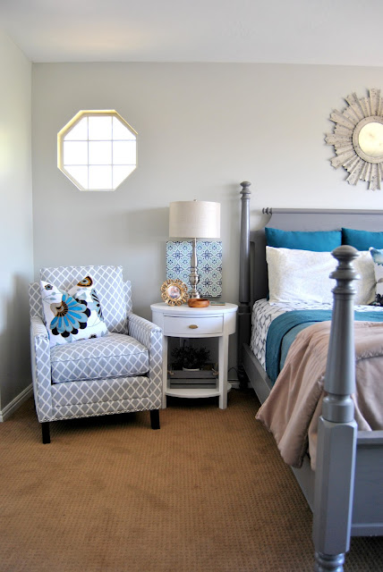 master bedroom, master, bed, room, gray, sunburst mirror, blue, gray, bench, pillows, gallery wall, accent chair, nail head, white, white night stand, night stand, oval, x base, xbase, fabric headboard, nailhead headboard, duvet, quilt, white, gray, lamp, brass, gold, silver, mixed metals