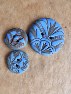 Three blue Polymer clay buttons with printed design