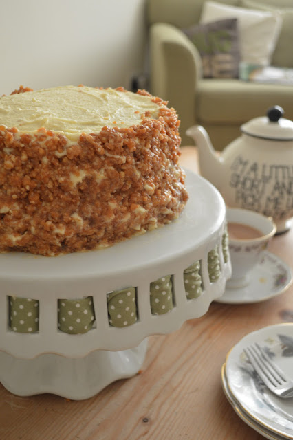 White chocolate, lemon and macadamia Genoise layer cake with a pot of tea