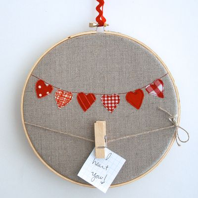 this adorable embroidery hoop art is made with love and little red fabric hearts