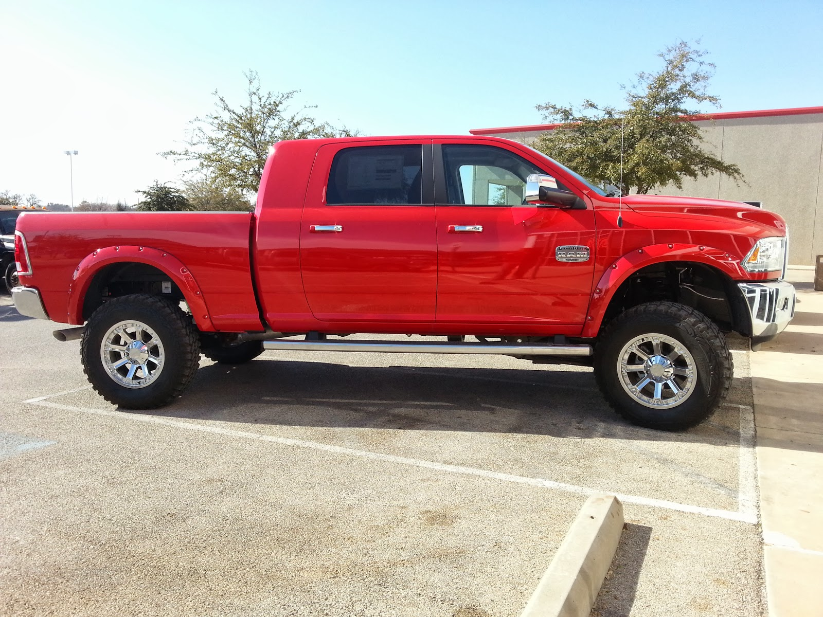 It s big it s bad it s red it s mud ready and tricked out 2014 ram 3500 mega cab cummins turbo diesel truck tdy sales 817 243 9840 call or text 24hrs
