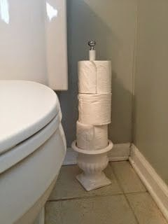http://www.hometalk.com/1720976/diy-toilet-paper-holder-from-a-pot-and-a-dowel?se=fol_new&tk=xlnl9y