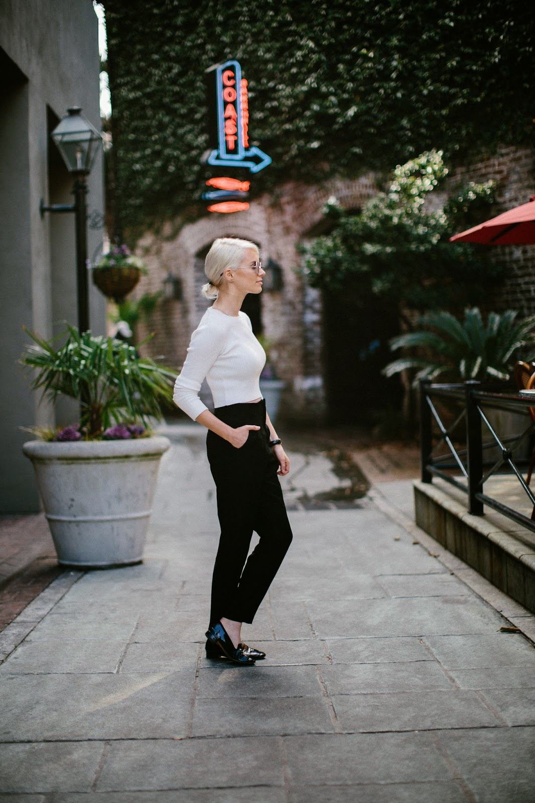 Charleston Fashion Blogger dannon k collard like the yogurt street style blog white cream ribbed long sleeve crop top black high waist classic trousers forever 21 patent leather loafers round toe daniel wellington sheffield lady black and rose gold watch round sunglasses platinum blonde hair tight bun parisian style guide european europe paris