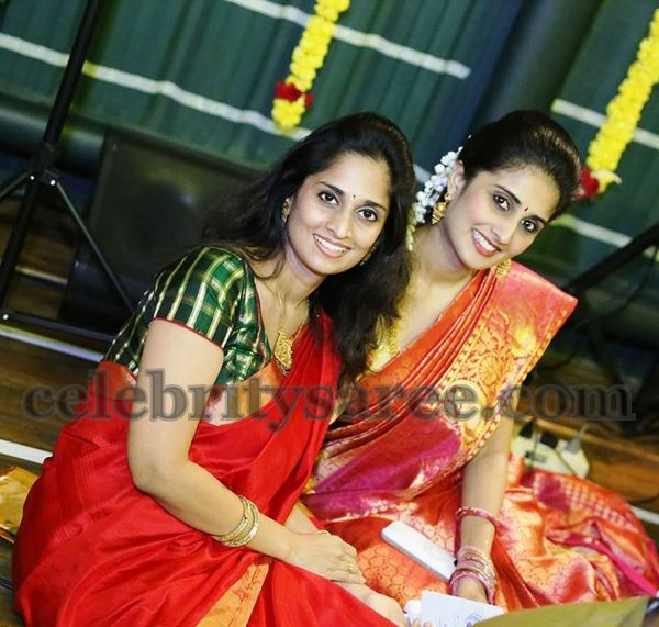 Pretty Sisters in Red Sarees