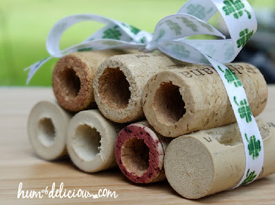 stack of seven corks tied with bow
