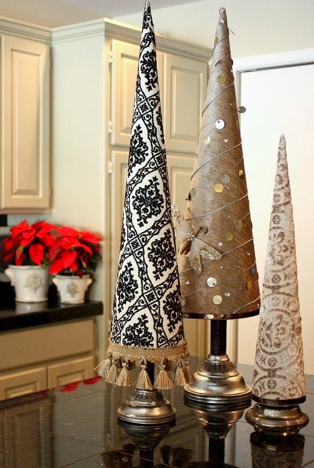 http://www.thecreativityexchange.com/2010/12/fabric-covered-poster-board-christmas-tree-cones.html