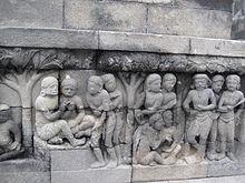 ukiran Karmawibhangga di dinding candi Borobudur (lantai 0 sudut tenggara)
