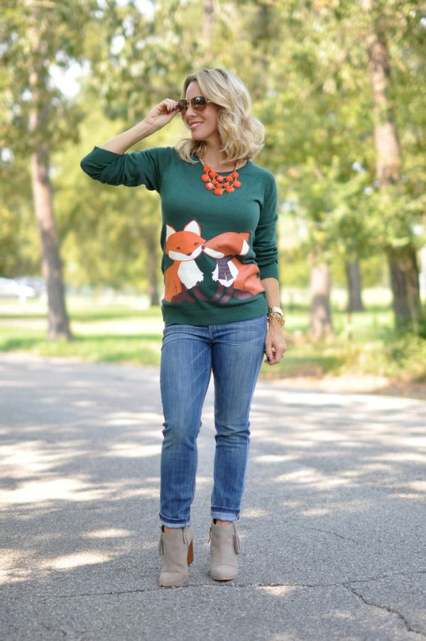 Fall fashion - super cute kissing fox sweater with rolled jeans and tassel bootie