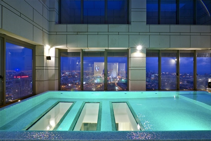Swimming pool with transparent bottom  Penthouse swimming pool