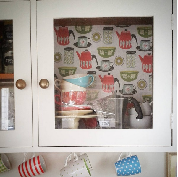 "My kitchen cupboard sporting retro ""wallpaper"" (gift wrap) from Good Thing"